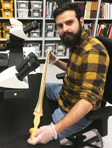 Valerio Gentile studying one of the swords at the microscope.