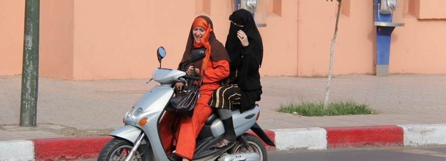 women on scooter in Rabat, Morocco