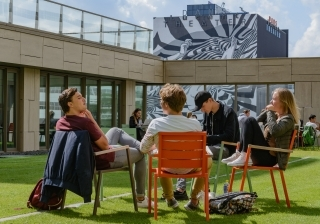 Students relaxing in the garden of the Wijnhaven building